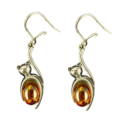You can tell these are happy little cats by their curled tails!  Set with two pieces of cognac colored amber.