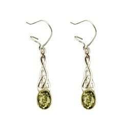 These genuine green color  Baltic Amber earrings are beautifully encased in a Celtic Sterling Silver design.