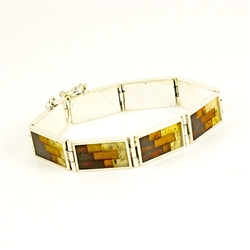 Hinged sterling silver cuff bracelet consists of 8 rectangular segments, inlaid with multi-color mosaic amber. The process to create this amber mosaic is quite unique.  See the video below.