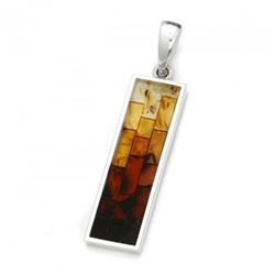 Stunning pendant with multi-color mosaic amber. The process to create this amber mosaic is quite unique. See the video below.