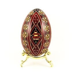 This beautifully designed and executed goose egg is hand painted by our artist from Canada using the traditional batik method. The egg has been emptied through two small holes at each end of the egg.
