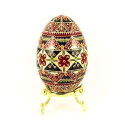 This beautifully designed and executed turkey egg is hand painted by our artist from Canada using the traditional batik method. The egg has been emptied through two small holes at each end of the egg. Stand sold separately.