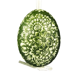 "This beautifully designed chicken egg is dyed one color and the design scratched into the egg using a sharp knife. The technique is called ""skrobanki"" in Polish. The eggs have been emptied and strung through with ribbon for hanging. No two eggs are exactl"