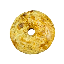 Lovely semi-polished doughnut shaped butterscotch amber stone for pendant use. Weighs 6.3g.
