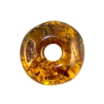 Very impressive polished doughnut shaped honey amber stone for pendant use. Weighs 6g.