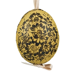 This beautifully designed brown chicken egg is hand painted. The painting is done in a traditional style from Opole. Ready to hang. Eggs are blown and can last for generations. Designs vary.