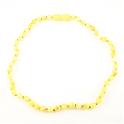 Lovely necklace composed of custard amber. Gold colored cord w/ knot between each bead. Perfect size for children over