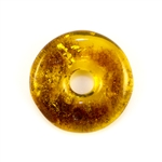 Very impressive polished doughnut shaped honey amber stone for pendant use. Weighs 4.9g. This amber stone is mainly polished but also has natural rough spots to highlight its natural origins.