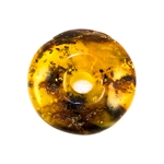 Very impressive polished doughnut shaped honey amber stone for pendant use. Weighs 11.2g. This amber stone is mainly polished but also has natural rough spots to highlight its natural origins.