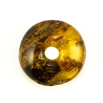 Very impressive polished doughnut shaped honey amber stone for pendant use. Weighs 12.2g. This amber stone is mainly polished but also has natural rough spots to highlight its natural origins.