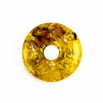Very impressive polished doughnut shaped honey amber stone for pendant use. Weighs 5.5g.  This amber stone is mainly polished but also has natural rough spots to highlight its natural origins.