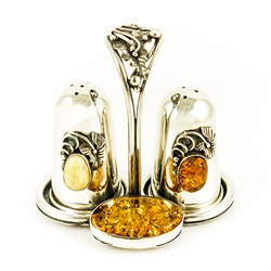 Very elegant sterling-silver salt and pepper set.  Consists of salt and pepper shakers and a holder. Only one available.