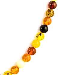 Delicate round multi-colored amber beads about .5cm in diameter. form this beautiful necklace.