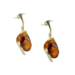 Stunning silver design holds and equally stunning marquis cut cognac amber cabochon.