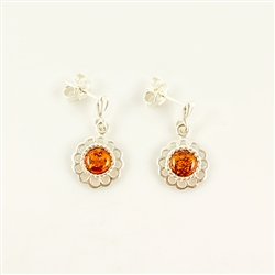 Honey amber circles centered inside an ornate Sterling Silver design.  Stylish and unique earrings.
