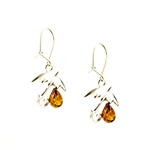 Genuine amber drops falling from these charming sterling silver umbrellas.