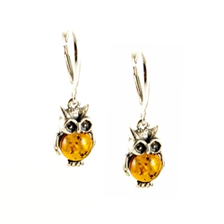 Charming sterling silver owl earrings with green amber eyes and honey tummy's.