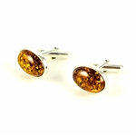 Beautiful pair of oval shaped silver cuff links highlighted with oval amber centers.