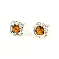 Beautiful pair of thin silver cuff links with centers of amber.