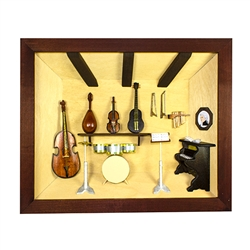Poland has a long history of craftsmen working with wood in southern Poland. Their workshops produce beautiful hand made boxes, plates and carvings. This shadow box is a look inside a music studio. Note the nice attention to detail. Entirely made by hand.