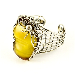 "Antiqued silver surrounds this stunning amber nugget (1.25"" x 2"" x .5"" - 3cm x 5cm x 1.2cm)."