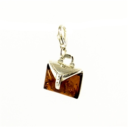 Very precious looking honey amber purse charm set in sterling silver.