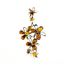 Golden drops of amber highlight this delightful sterling silver pendant.