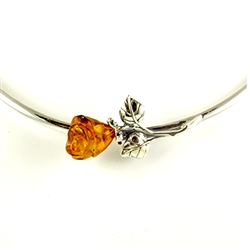 Hand carved amber rose is the centerpiece of this beautiful adjustable silver collar.