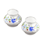 A pair of adorable porcelain salt and pepper shakers decorated with a traditional Kashubian floral design.  Hand wash only.
