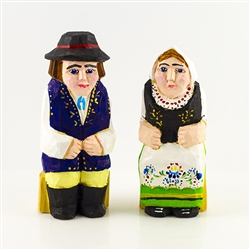 Hand carved and painted by folk artist Tadeusz Lesniak, our little couple is dressed in Kashubian costume from Northern Poland.