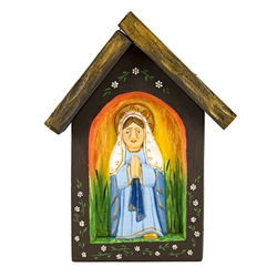 All over the Polish countryside you can find wonderful religious roadside shrines.  The folk carving of Mary is reminiscent in shape and style to those shrines.  Hand carved and painted by folk artist Bogumila Lesniak. Ready to hang.