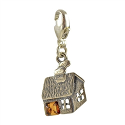 Very precious looking honey amber house charm in sterling silver.