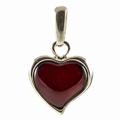 "Hand made with Sterling Silver detail. In this batch the amber is not quite as dark as pictured. Size is approx. 1"" x .6"""