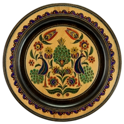 Hand Made in Southern Poland. This Polish plate is made from beech wood in the mountain region of southern Poland called Podhale. The plates are cut and shaped on a lathe by hand. The floral designs are burned into the wood then painted after staining and