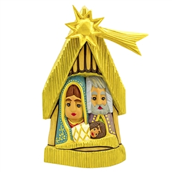 The Christmas Nativity carved and painted by Polish folk artist Andrzej Cichon from Kutno. Mr Cichon signs his work by carving a stylized version of his initials on the bottom of this carving.  Carved from one block of wood.