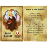 St Benedict Holy Card This unique prayer card contains a third class relics on the front with the prayer on the back. Please note that these are third class relics and are not first or second class with a piece of cloth touched to the relics.