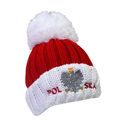 Display your Polish heritage!! Red and red stretch ribbed-knit winter cap with the word Polska and an embroidered Polish Eagle.. Easy care acrylic fabric. Once size fits most. Made In Poland.