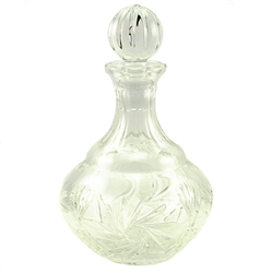 This is genuine Polish hand-cut leaded crystal decanter with matching crystal stopper.  Beautiful starburst cut is a classical pattern found in traditional Polish crystal.
