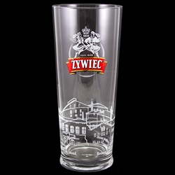 "Zywiec beer is one of Poland's most popular and oldest brands. This is a 1/2 liter capacity tall glass glass featuring the company's logo with dancers as well as a factory profile around the bottom of the glass and the company motto: ""Trzymamy Sie Zasad"""
