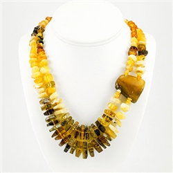 Bozena Przytocka is a designer of artistic amber jewelry based in Gdansk, Poland. Here is a beautiful example of her ability to blend multiple shades of amber to create a stunning necklace Knotted between each bead.