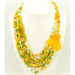 Bozena Przytocka is a designer of artistic amber jewelry based in Gdansk, Poland.   Here is a beautiful example of her ability to blend amber, aquamarine and peridot to create a stunning necklace.  Features two beautifully carved amber roses.
