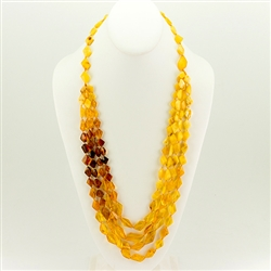 Bozena Przytocka is a designer of artistic amber jewelry based in Gdansk, Poland. Here is a beautiful example of her ability to blend multiple shades of amber to create a stunning necklace.