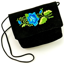 "Hand embroidered clutch purse made from velvet. Fully lined. 17"" long strap.  Snap closure. Made in Lowicz, Poland."