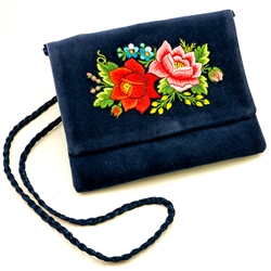 "Hand embroidered clutch purse made from velvet. Fully lined. Extra long strap (extends to 25""). Snap closure. Made in Lowicz, Poland. Flower colors and design vary slightly from purse to purse."