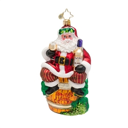 "This ornament features Santa Claus sitting on a barrel that says ""Santa's Wine Cellar"" with a glass of white wine in his hand."