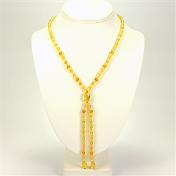 "Composed of alternating citrine and custard color round amber beads ending with a large citrine amber oval bead attaching 2 additional 4"" strands. Very elegant."