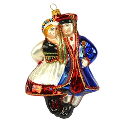 Add a lively vibe to your holiday celebrations with our unique Polish folk dancing couple ornament! Skillfully crafted of glass in Poland, this colorful depiction of traditional Krakowiak dancers is artfully hand-painted with bright glazes and sparkling g