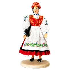 Our young lady is dressed in a Kaszub outfit reserved for special ceremonies. This costume can come in either red or green. The Kaszub region is located in northern Poland.  You can learn more about this region here:  http://en.wikipedia.org/wiki/Kashubia