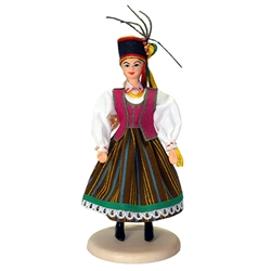 Our young lady is dressed in the costume from Kurpie.  The Kurpie region is located in Poland on a lowland plain called the Mazovian Region (Mazowsze), which was once covered over by two forests known as the Puszcza Zielona (the Green Wilderness) and the