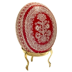 This beautifully designed egg is dyed one color, then white wax is melted and applied to form an intricate design which is left on the surface. The egg is emptied through one hole in the bottom.